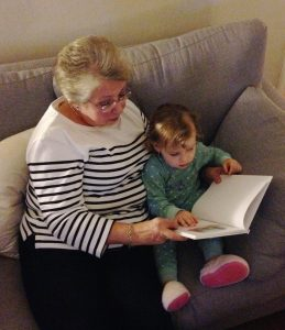 Grandma reading Berties book to granddaughter